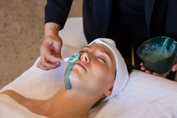 Woman getting Dermaplaining with Algae Mask