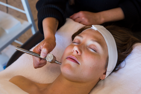 Woman getting Mini Glow Facial