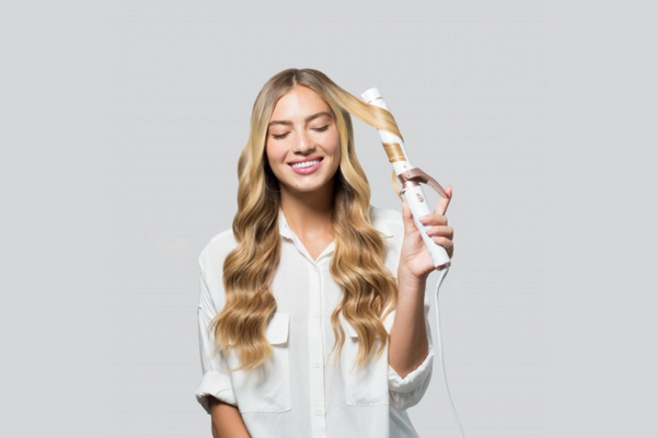 "Girl using T3 Micro Interchangeable 1.25"" Clip Barrel Curling Iron Twirl Convertible"