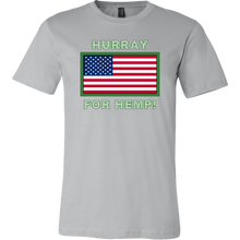 "Load image into Gallery viewer, ""Hurray for Hemp!"" written in tiny Hemp Leaves above USA flag T-shirt"