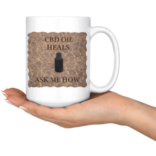 "Load image into Gallery viewer, ""CBD Oil Heals Ask Me How"" Brown Bottle on Copper Oil Background-15 oz. white ceramic mug"