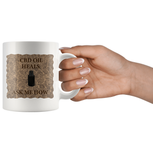 """CBD Oil Heals Ask Me How"" Brown Bottle on Copper Oil Background-11 oz. white ceramic mug"