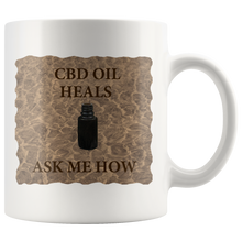 "Load image into Gallery viewer, ""CBD Oil Heals Ask Me How"" Brown Bottle on Copper Oil Background-11 oz. white ceramic mug"