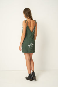 Clementine Mini Dress – Blossom – Mustang Green by Rue Stiic Online at Jessie sue with FREE EXPRESS shipping in Australia, no minimum spend, AFTERPAY, FREE RETURNS within Australia, 100% SAFE & SECURE. The Clementine Mini Dress is cut from soft rayon, and is hand screen printed. This feminine style has a v-shaped neckline with straps that tie on the shoulder