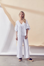 Load image into Gallery viewer, Grove Top - White by Lune Resort Online at Jessie sue with FREE EXPRESS shipping in Australia, no minimum spend, AFTERPAY, FREE RETURNS within Australia, 100% SAFE & SECURE. 100% Cotton. Billowed top. Ruche elbow length sleeves. V neckline. Pleating from the bust. Model wears size S / 8 AU / 4 US. Cold hand wash or dry clean only. Always check the garment care label for specific care instructions