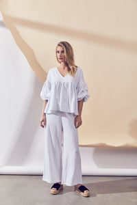 Grove Top - White by Lune Resort Online at Jessie sue with FREE EXPRESS shipping in Australia, no minimum spend, AFTERPAY, FREE RETURNS within Australia, 100% SAFE & SECURE. 100% Cotton. Billowed top. Ruche elbow length sleeves. V neckline. Pleating from the bust. Model wears size S / 8 AU / 4 US. Cold hand wash or dry clean only. Always check the garment care label for specific care instructions