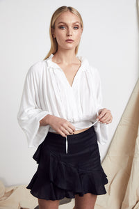 Luciano Skirt Black Linen by MLM Label Online at Jessie with FREE EXPRESS shipping & FREE RETURNS in Australia. FREE STANDARD shipping WORLDWIDE (minimum spend $150), AFTERPAY.  $20 OFF your first order, 100% SAFE & SECURE. Mid rise  Fitted with slight flare Ruffle trimming Invisible zip at the centre back Linen Cotton Blend