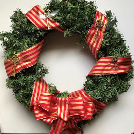 Harry Potter Inspired Holiday Wreath decorated with Flying Keys and bow