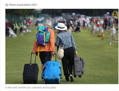 Man and woman with suitcase