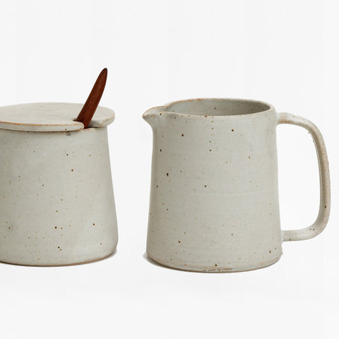 small pitcher and covered sugar