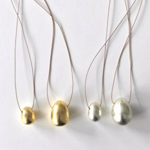Carol Leskanic egg necklaces