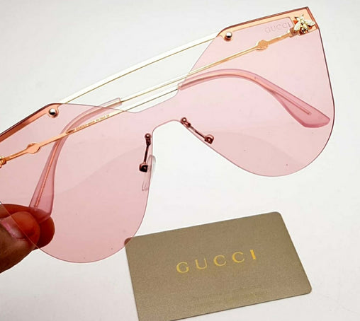 Pink Gucci women's sunglasses