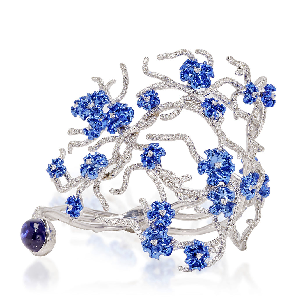 White gold stem bracelet studded with blue rhodium blooms, diamonds and finished with a cabachon tanzanite by Neha Dani available at Macklowe Gallery