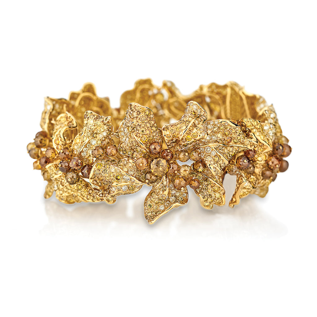 Golden autumn leaf bracelet studded with yellow diamonds by Neha Dani available at Macklowe Gallery