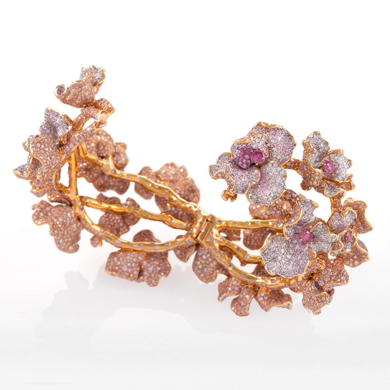 18kt rose gold bracelet of stems and pink blooms studded with over 11,000 pink diamonds by Neha Dani available at Macklowe Gallery