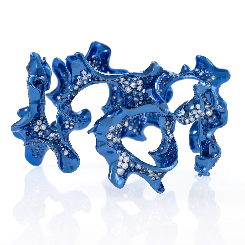 Swirling blue rhodium plated cuff with diamonds and sapphires