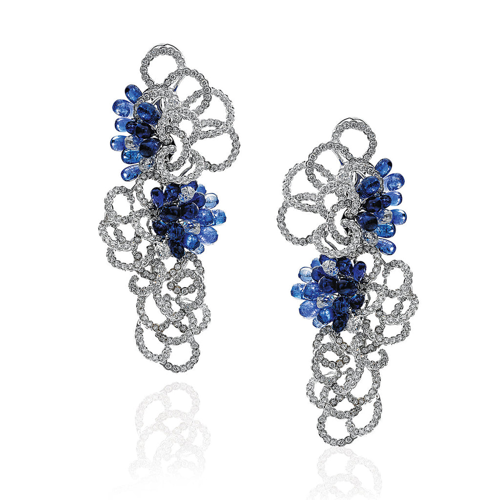 Diamond and sapphire drop earrings in an interlocking concentric motif by Neha Dani Available at Macklowe Gallery