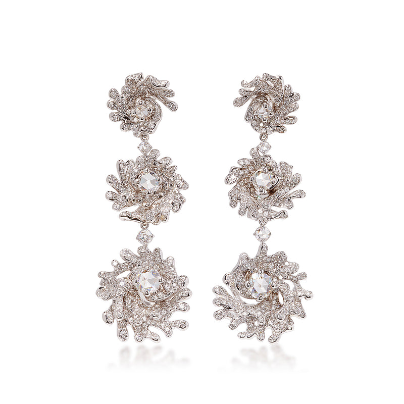 Convertible earring featuring three concentric diamond studded motifs