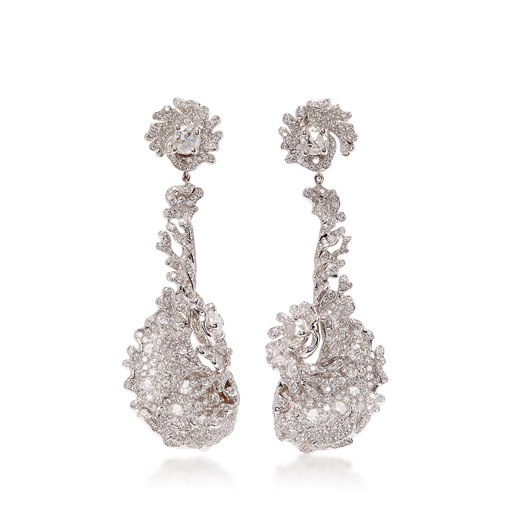 Wave like swirling diamond drop earrings