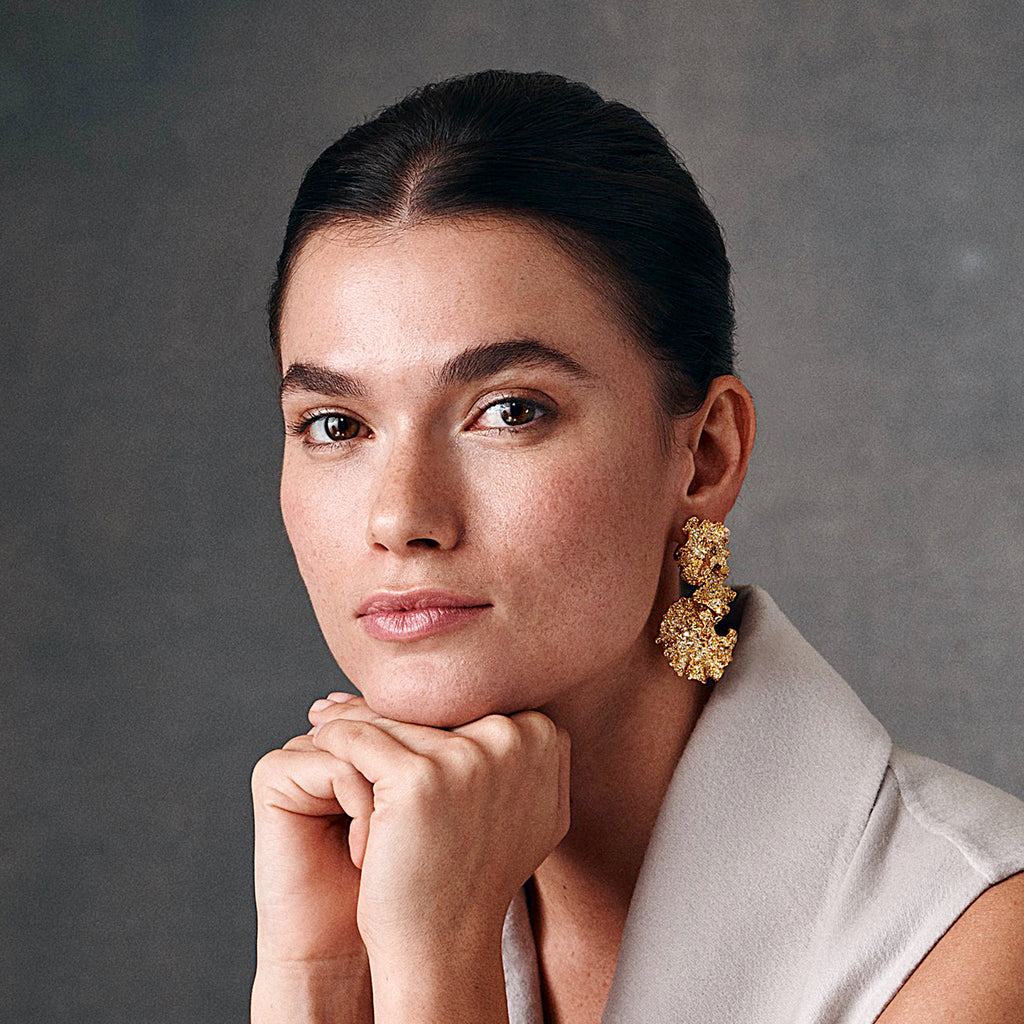Model showing Shiri earrings, interlinked leaves in gold and diamond