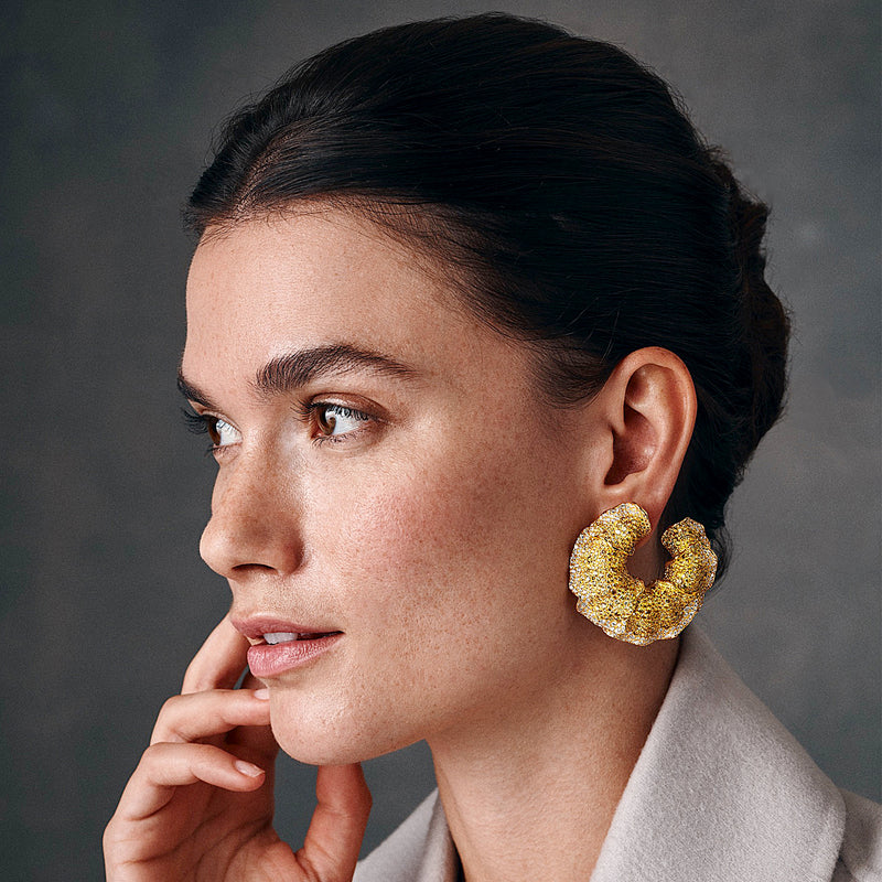 Model showing Intricate yellow diamond concentric earrings