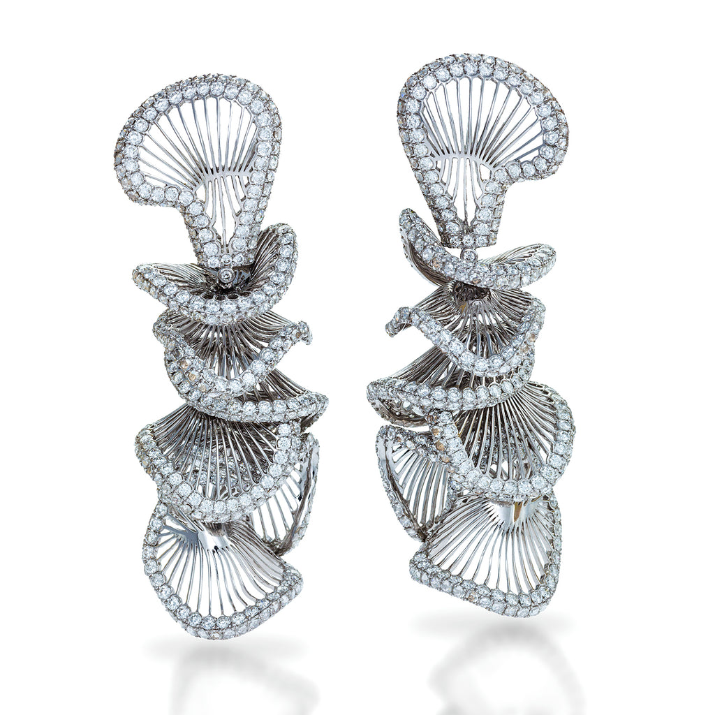 White gold earrings featuring seven undulated concentric links of delicate openwork outlined by round brilliant diamonds by Neha Dani available at Macklowe Gallery