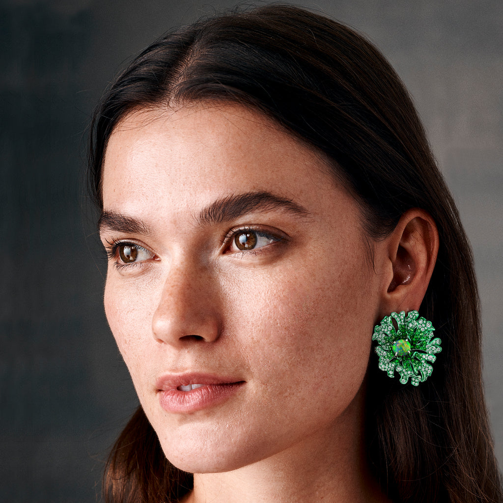 green rhodium plated white gold earrings centering on black opals and studded with diamonds and tsavorite garnets by Neha Dani available at Macklowe Gallery