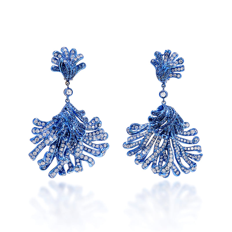 Blue rhodium plated underwater bloom earrings studded with white diamonds and sapphires by Neha Dani available at Macklowe Gallery