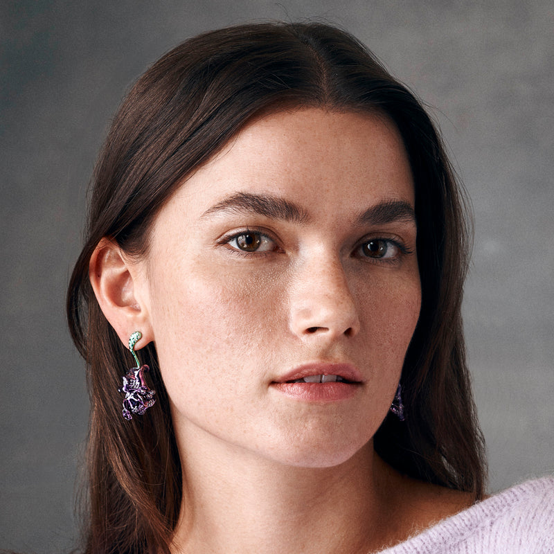 Model showing green and purple rhodium plated earring