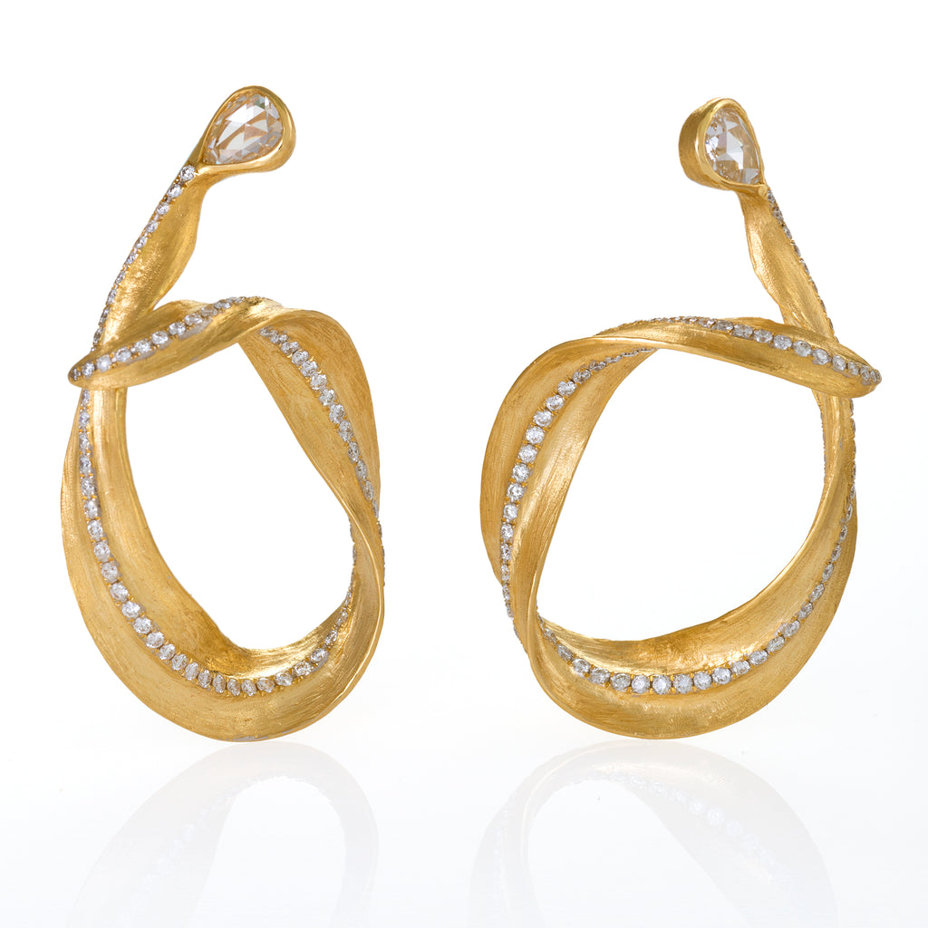 Yellow gold earrings take the form of a delicate eucalyptus leaf