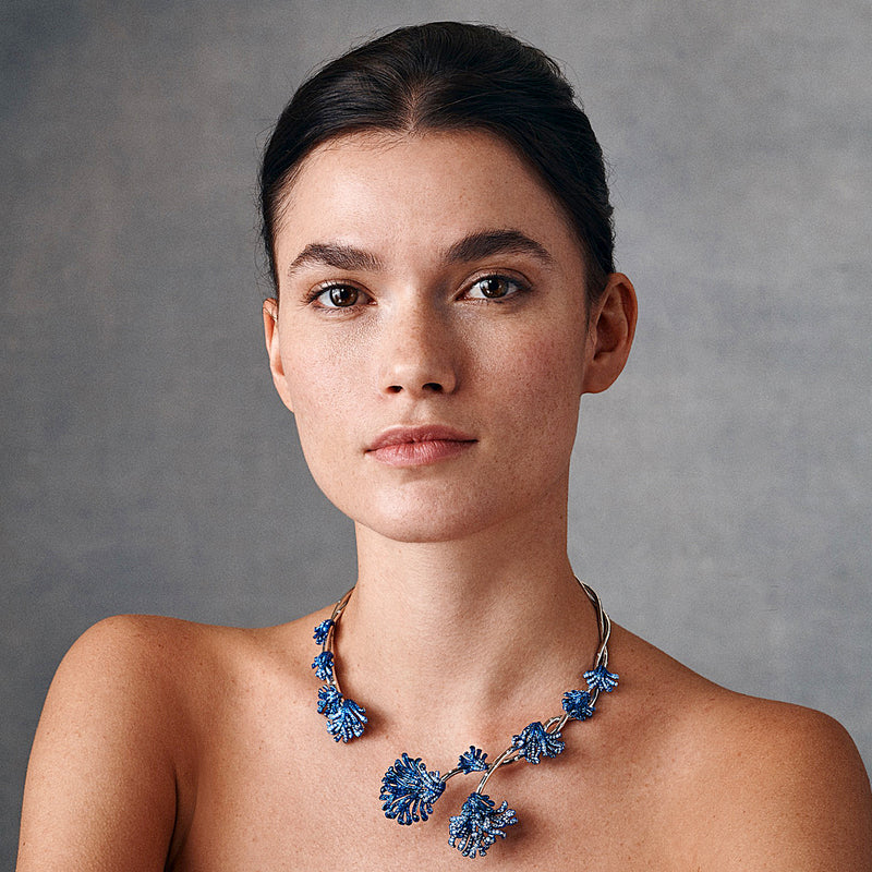 White gold and blue rhodium plated collar necklace with diamonds and sapphires by Neha Dani available at Macklowe Gallery