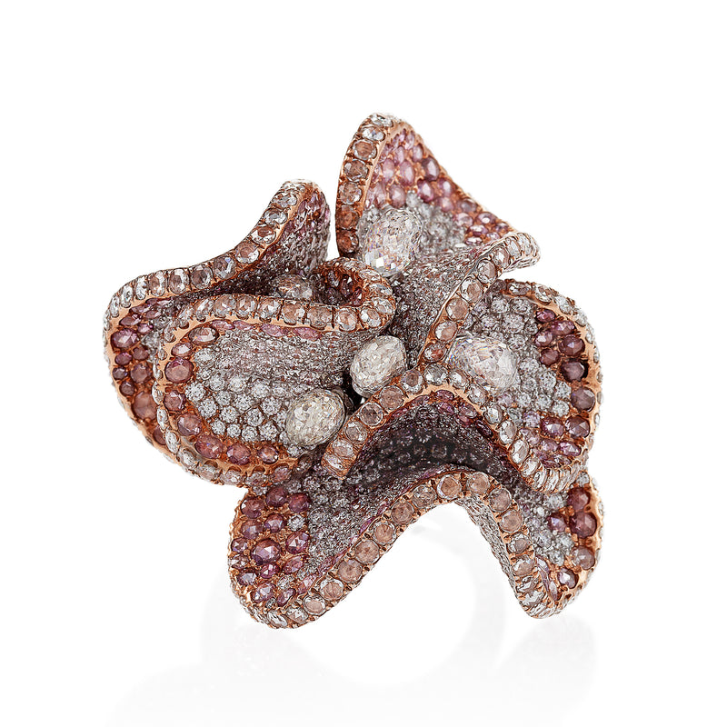 large floral ring with pink and white diamonds by neha dani available at Macklowe Gallery