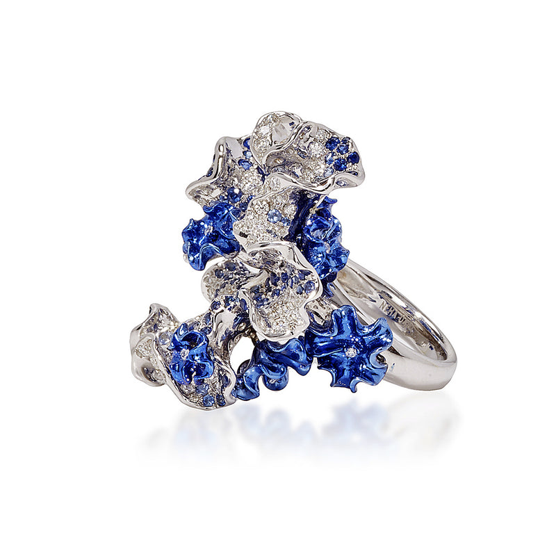 White gold and blue rhodium bloom ring studded with white diamond and sapphires by Neha Dani available at Macklowe Gallery