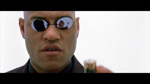 Morpheus from The Matrix wearing Pince-Nez style sunglasses with a black mirror lens.