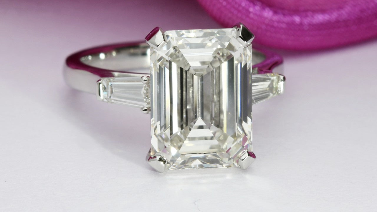 Tapered baguette emerald cut engagement ring