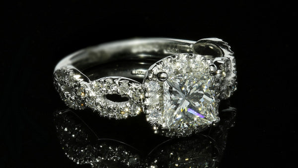 Halo engagement ring with twist