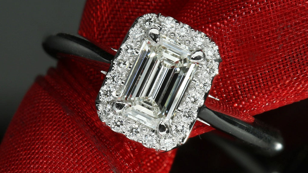 Solitaire emerald cut halo engagement ring