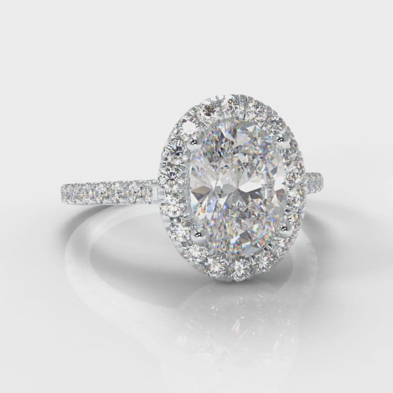 Halo engagement ring set with 1ct oval diamond