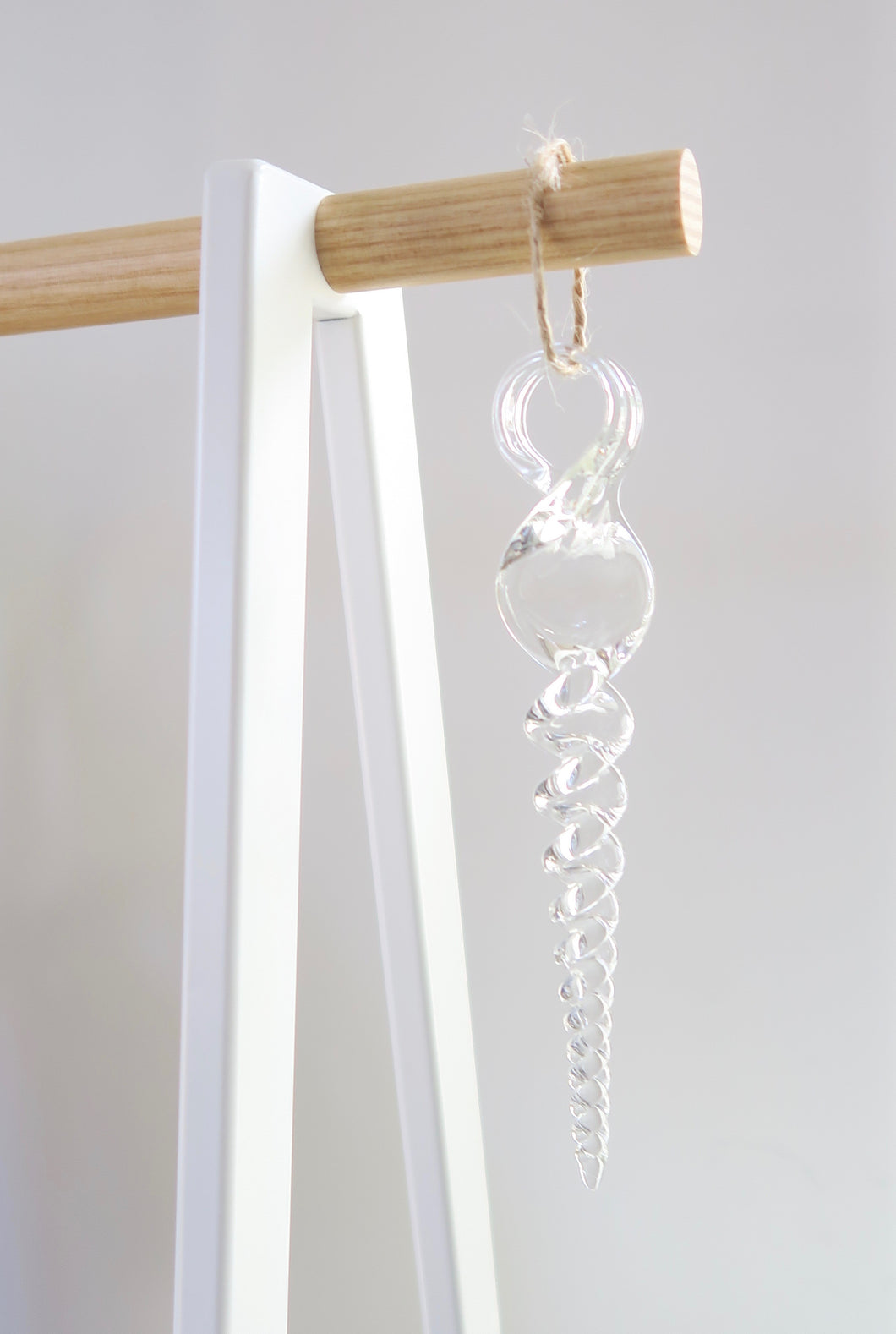 glass icicle hanging on a dowel
