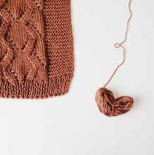 Load image into Gallery viewer, Flat lay of a wool knitting project