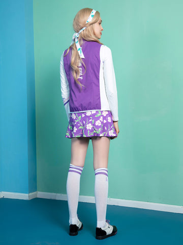 Women's purple pleated skirt, in all-over floral print.