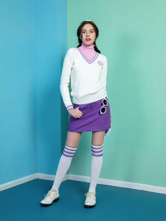 Women's long sleeve sweater with mock neck, in white, purple and pink stripe trims.