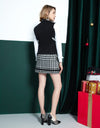 Women's A-line tweed skirt, in black and white houndstooth print.