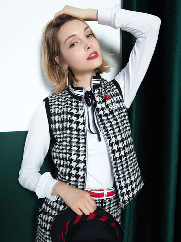 Women's zip-up tweed vest with padding, in black and white color blocking.