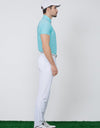 Men's short sleeve layering top with stand zipped collar, in green.