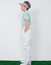 Boy's green short sleeve polo, in all-over logo print