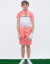 Boy's short sleeve polo, with black trim, orange and white color blocking.