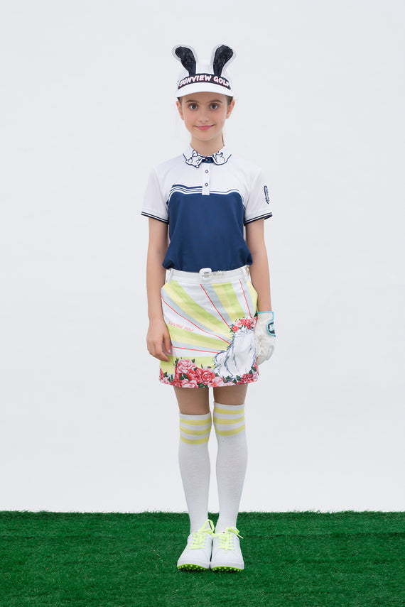 Girl's short sleeve polo with cat shape print, in navy and white color blocking.