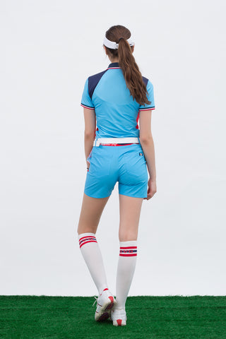 Women's short sleeve polo, in blue, navy and red color blocking.