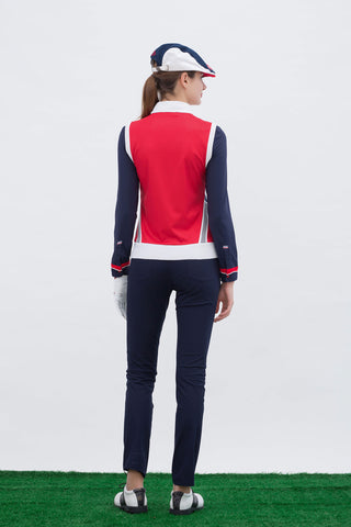 Women's knitted vest with stand collar, in red and navy color blocking.